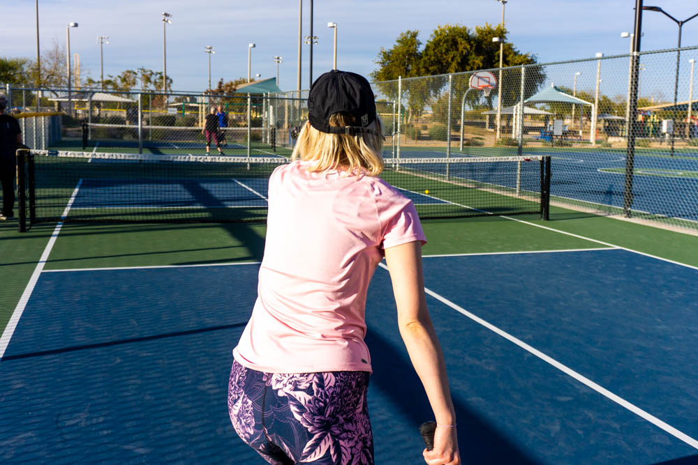 Woman serving in Pickleball game