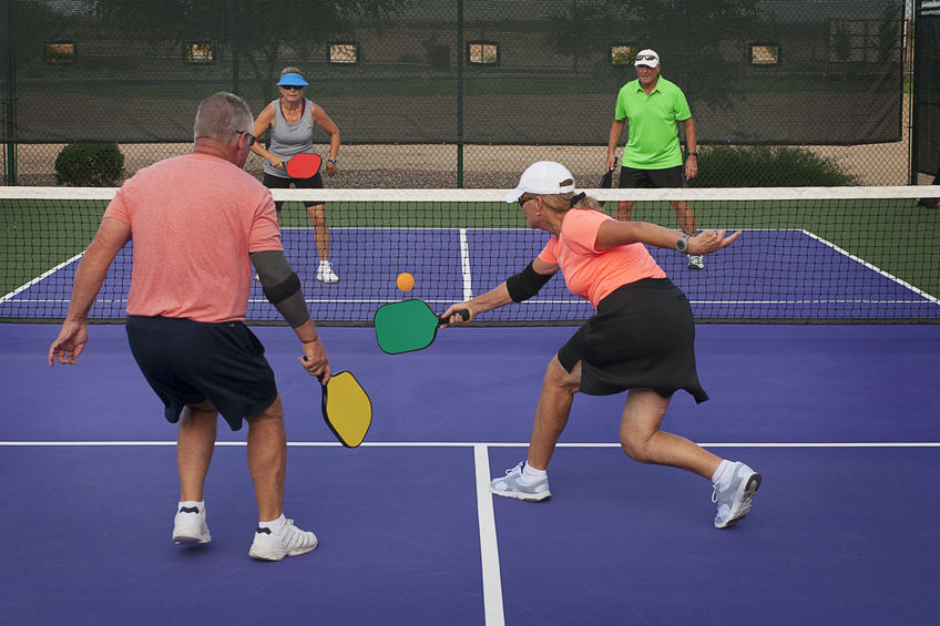 A doubles pickleball game in action